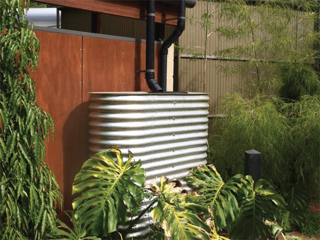 Slimline water tank installed in a backyard
